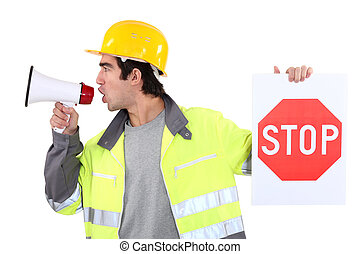 Man with megaphone holding stop sign