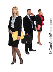 Three business colleagues with folders