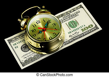 Alarm clock and money 02 - The oldfashioned alarm clock on...