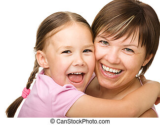 Portrait of a happy mother hugging her daughter