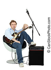 Teenager boy with electric guitar and amp