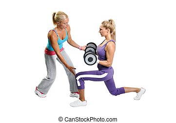 Athlete woman exercising with personal fitness trainer on a...