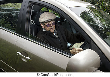 Old man driving a car
