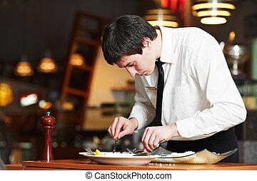 working waiter in uniform at restaurant