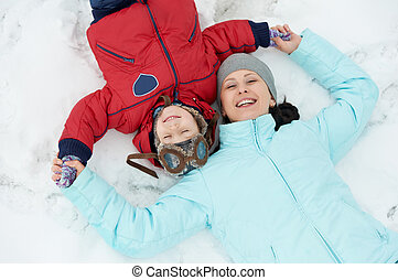 Mother with child boy son at winter - Portrait of happy...