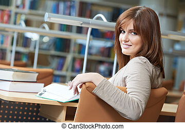 young student girl study with book in library