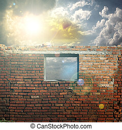 Sky with sunlight through the hole in the brick wall