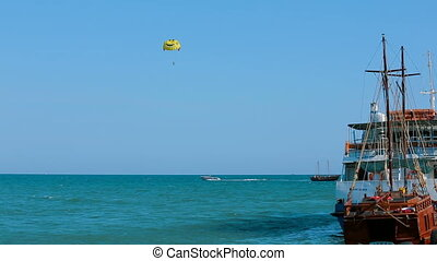 Gliding above the sea - Parafoil gliding above the sea on a...