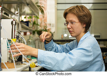 Scientist,laboratory 3 - The young nice woman-scientist work...
