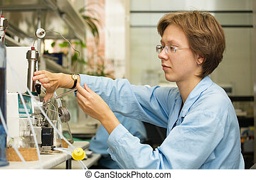 Scientist,laboratory 4 - The young nice woman-scientist work...
