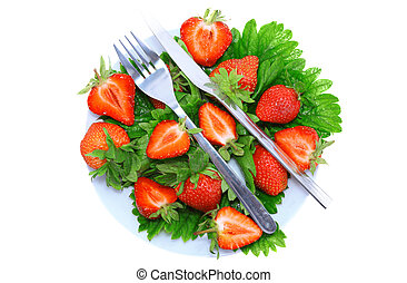Strawberries with fork and knife . Isolated