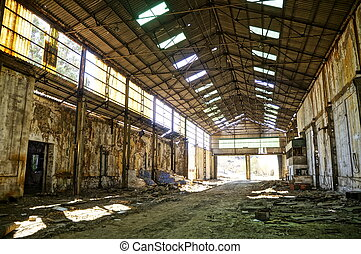 Abandoned empty warehouse - The interior of a machine hall...