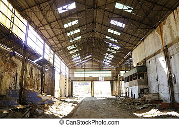 Deserted factory - The interior of a machine hall at an...