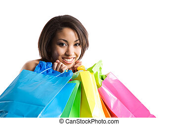 Shopping woman - An isolated shot of a black woman carrying...
