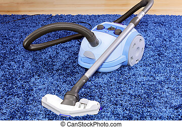 Vacuum cleaner stand on blue carpet - Powerful vacuum...