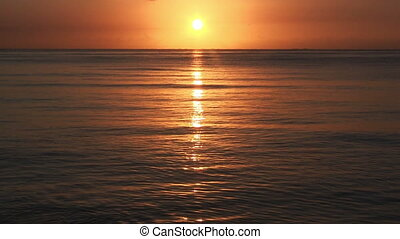 Sunrise over sea, tranquil landscape