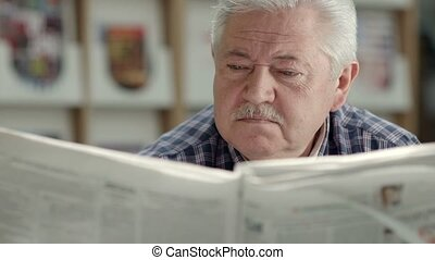 Elderly man reading newspaper - Seniors and active...