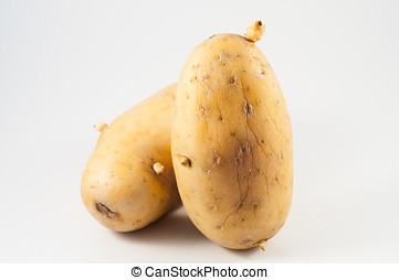 Potatos - Two potatoes isolated photographed in close-up