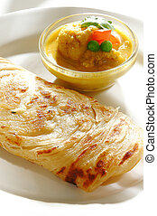 Indian prata - Indian wheat flour pancake and dipped into...