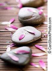 hot stone therapy  - stones sprinkled with petals