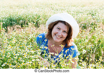 The woman on the daisy field