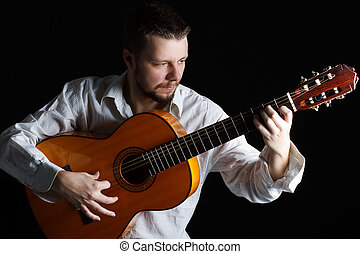 Man playing the guitar - Portrait of a young man playing the...