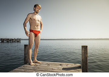 man at the lake - An image of a handsome man at the lake