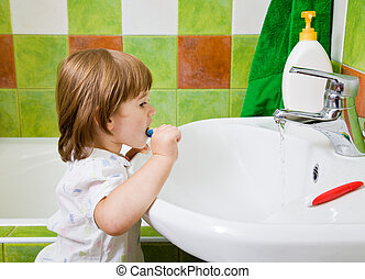 girl brushes teeth. - Personal hygiene. Care of an oral...