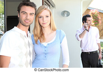 Couple viewing a house with an agent