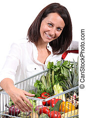 Woman with a trolley full of vegetables