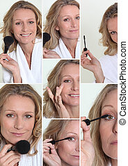 Woman in bathrobe putting make-up on