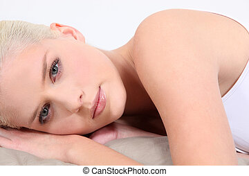 Attractive woman lying down