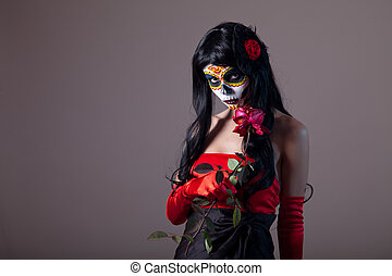 Sugar skull girl holding red rose, Day of the Dead Halloween...