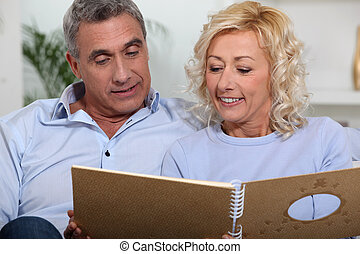 Couple looking at a photo album