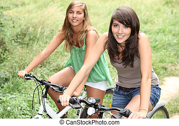 Two girls on a bicycle