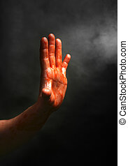 Rescue me - Mans hand on a black background with a smoke