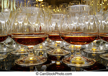 glasses of brandy at the banquet - Glasses with cognac on...