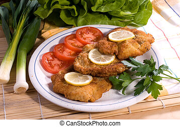 wiener schnitzel served - delicious dinner and vegetable