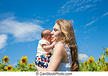 Happy mother and newborn child - happy young woman holds the...
