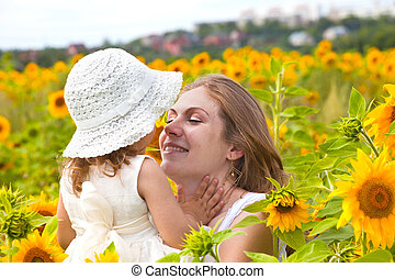 Mother and daughter - happy young woman holds the  child