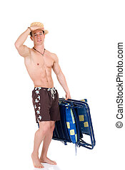 Body Builder, beach chair - Young attractive male body...