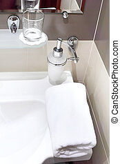 Faucet with soap dispenser in bathroom