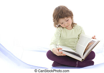 A young girl reading a book. Isolated on white background