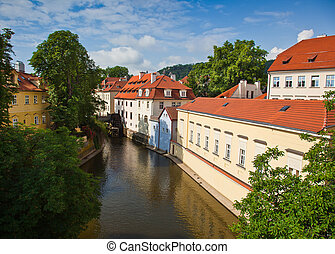 Old water-mill and water wheel - River Vltava. Old...