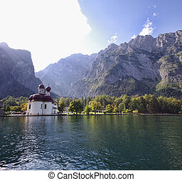 church and lake in autumn - Saint Bartholomew church in...