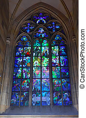 Stained-glass window in Catholic temple. Prague