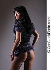 beautiful woman looking back - beautiful brunette woman in...