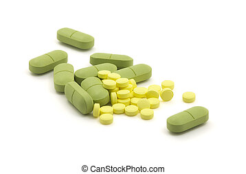 Green and yellow pills with dose on white background
