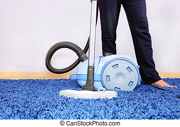 Vacuum cleaner in action-men cleaner a carpet. - Powelful...