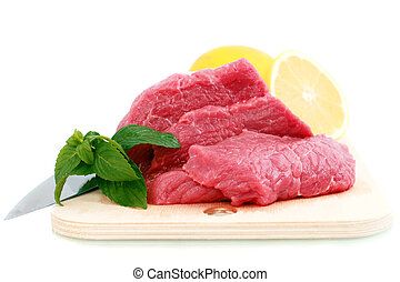 Cut of beef steak, knife with lemon slice Isolated